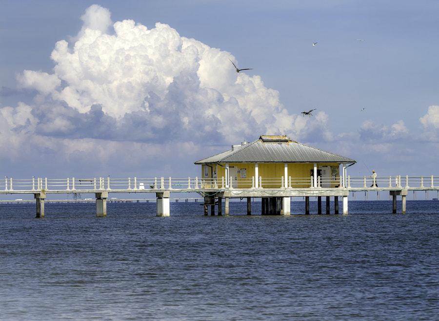 yellow building on fishing pier