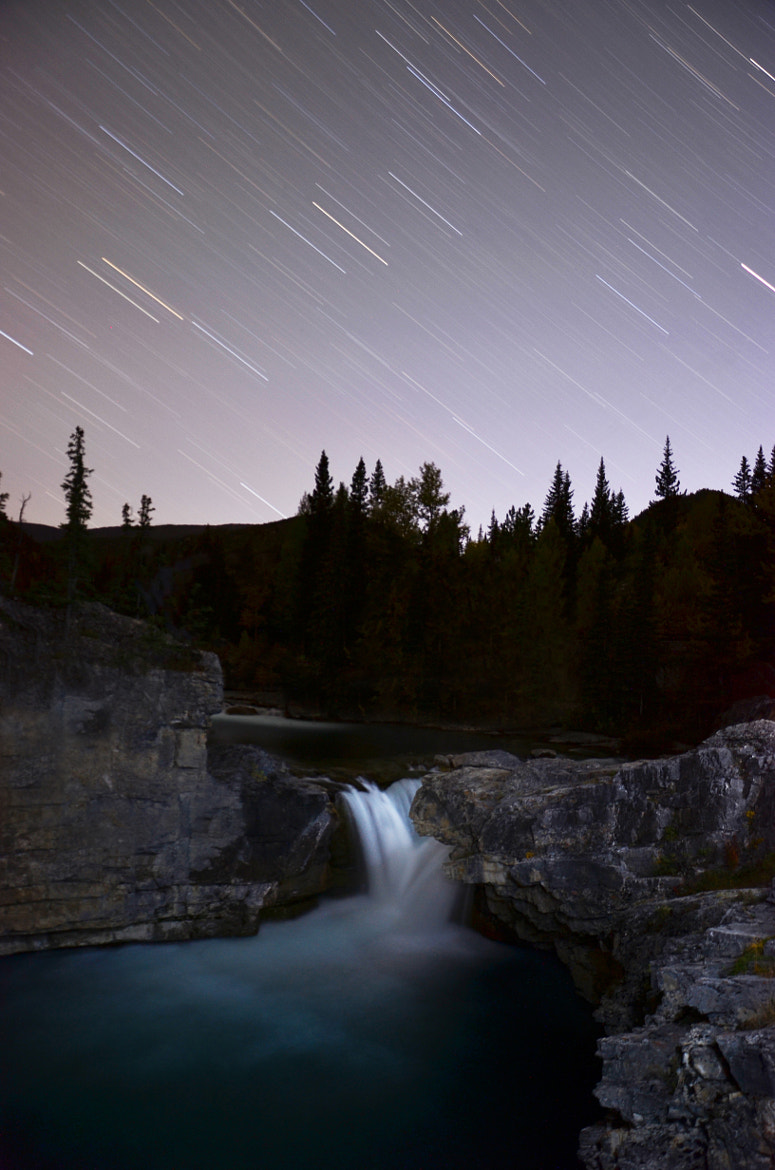 Photograph Star trails over elbow falls by Thomas Kennedy on 500px