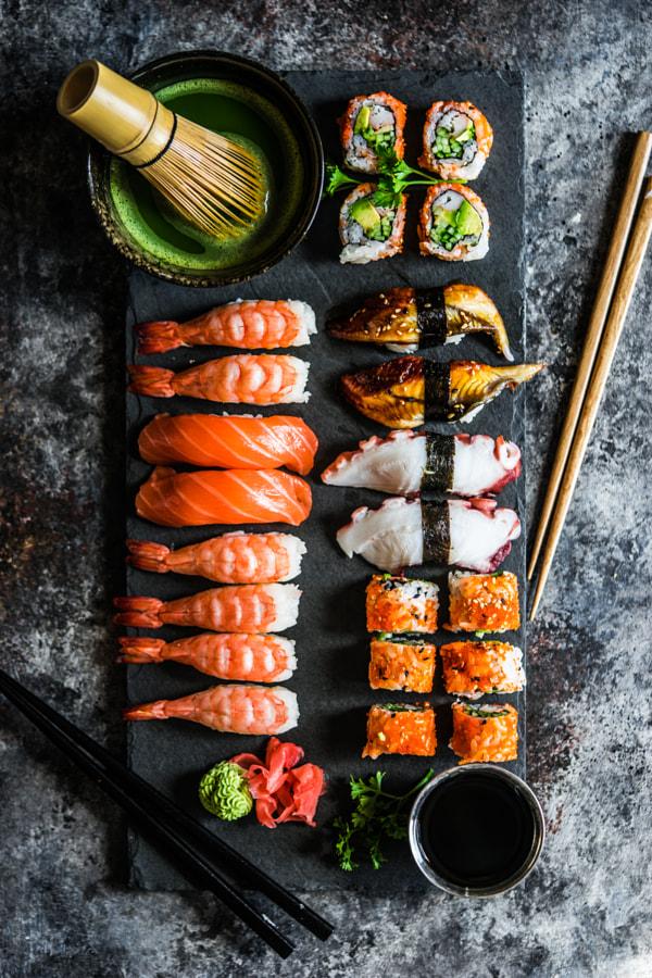 Sushi and sashimi variety on rustic background by Alena Haurylik on 500px.com