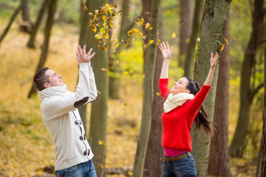 Couple on a walk in autumn park throwing leaves by Jozef Polc on 500px.com
