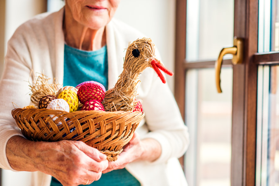 Woman holding basket with Easter eggs and straw hen by Jozef Polc on 500px.com