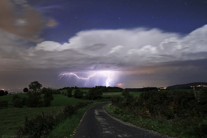 Photograph Thunderstorm under the Stars by Florent Courty on 500px