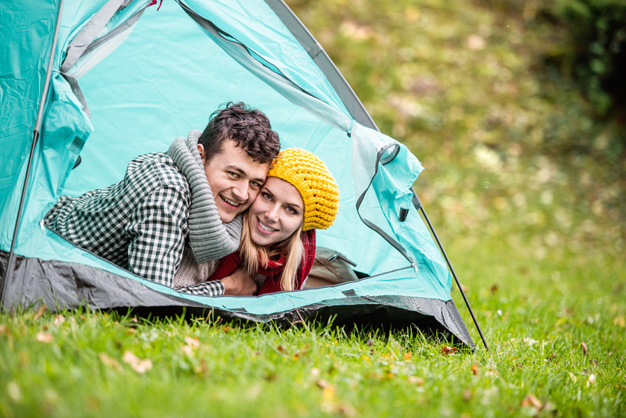 Beautiful couple lying in tent, camping in autumn nature by Jozef Polc on 500px.com