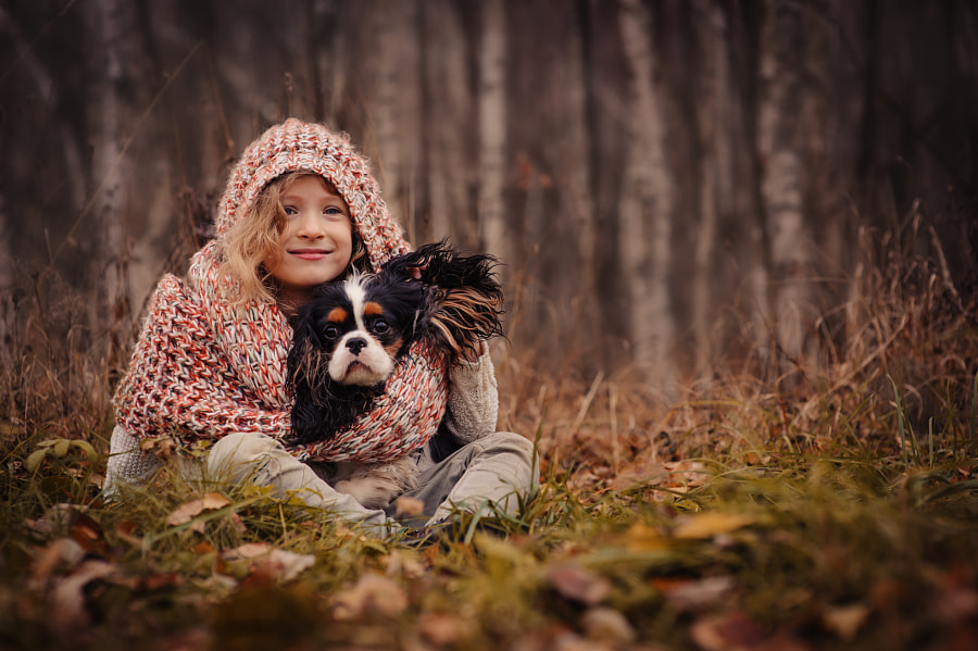 child girl playing with her dog in autumn by Maria Kovalevskaya on 500px.com