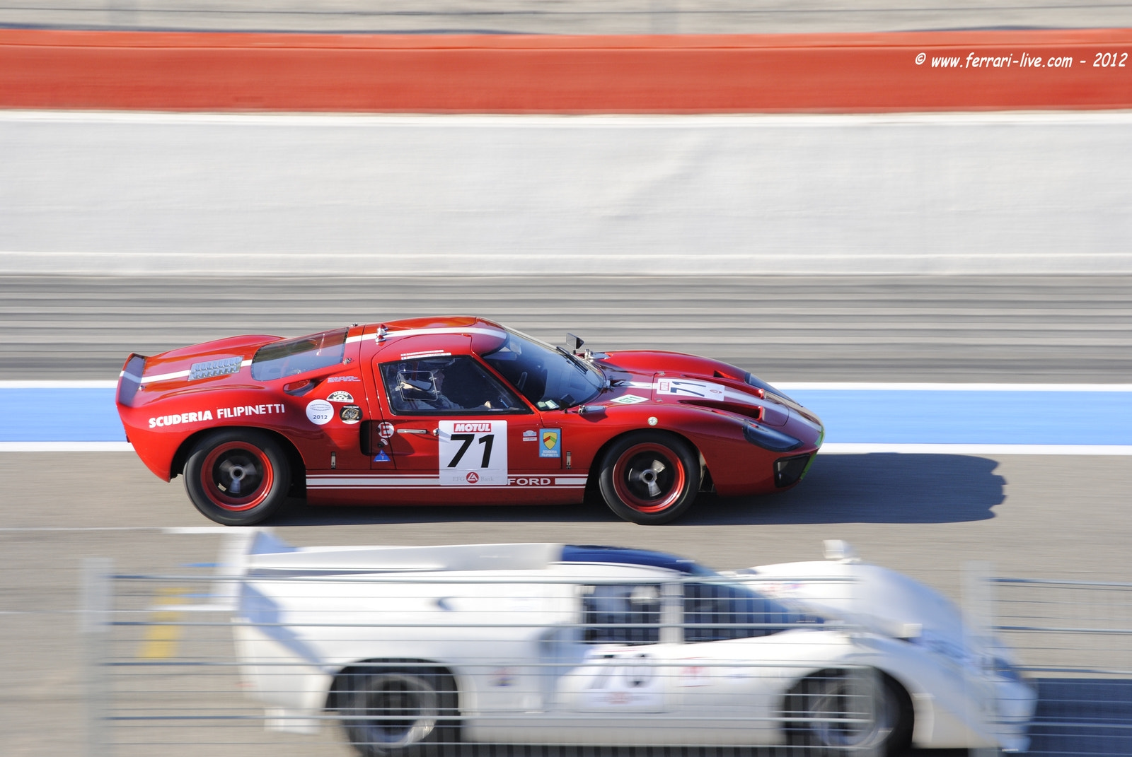 Photograph Panning Ford GT 40 red by Ferrari-live @ Franck on 500px