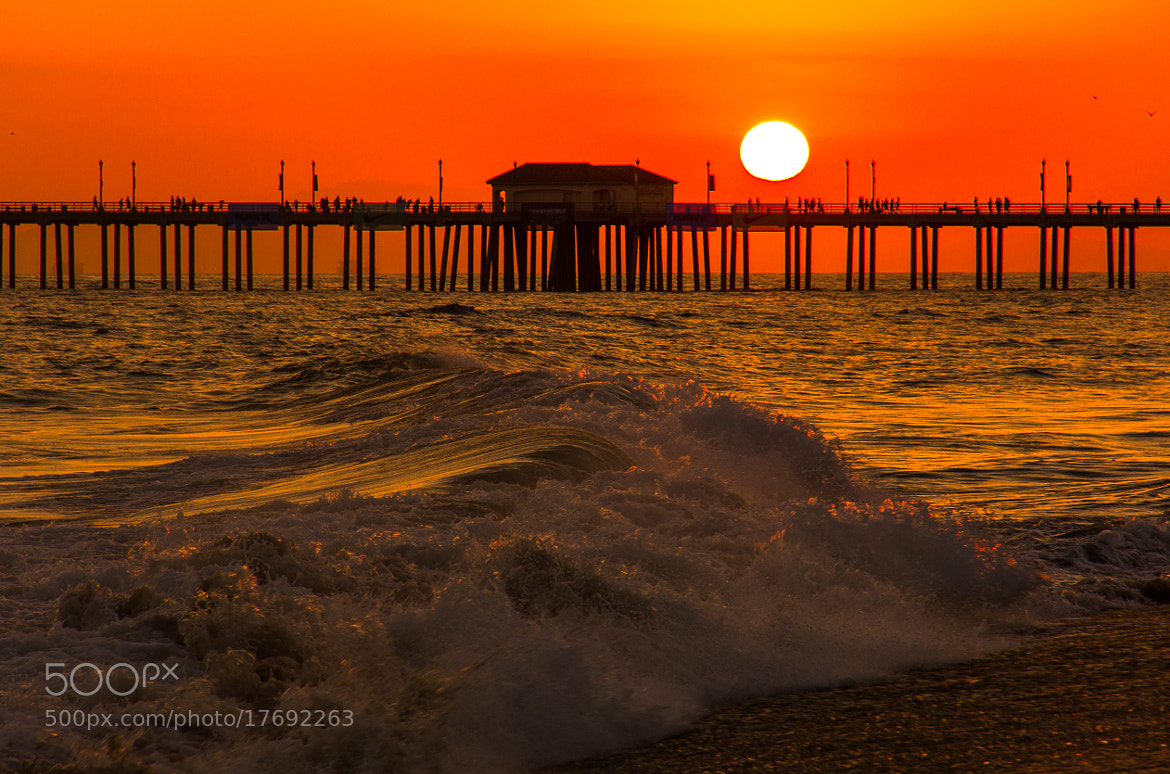 Photograph Sun above the pier of Huntington beach by Aidan Jungo on 500px