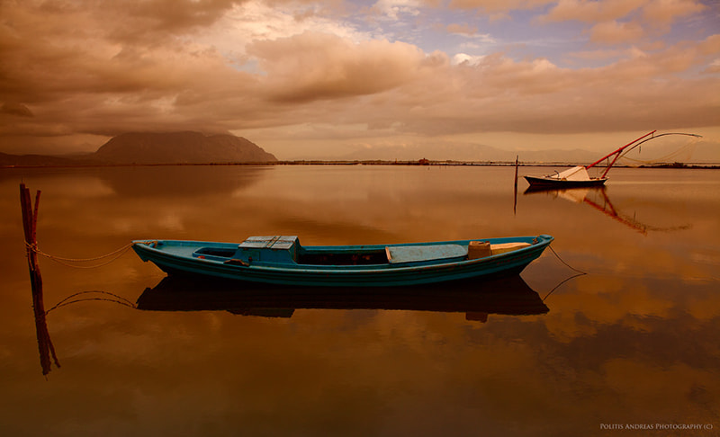 Photograph Floating Boats by Andreas Politis on 500px