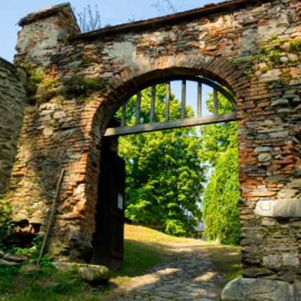 Pernštej Castle - stone brick wall and wooden gate