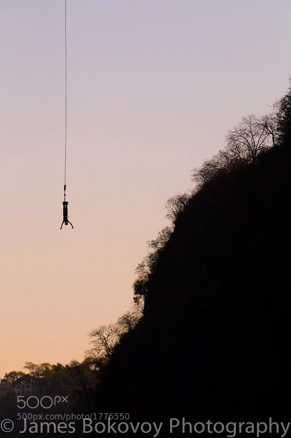 A tourist enjoys some free-fall time on the bungee that is suspended from Victoria Falls Bridge.