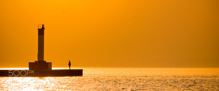 Morning fisherman on Lake Ontario.