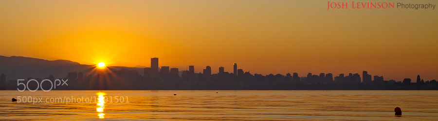 Photograph Downtown Vancouver, just as the sun was rising above the mountai by Josh Levinson on 500px