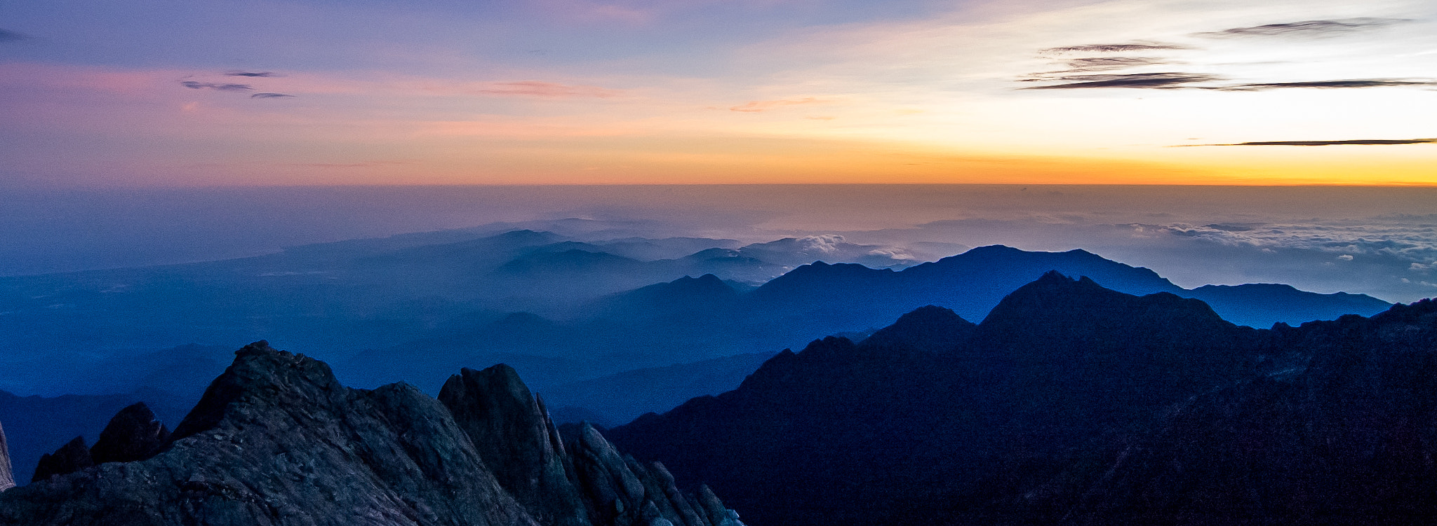 Photograph Sunrise from Mt Kinabalu by Tom Kirkwood on 500px