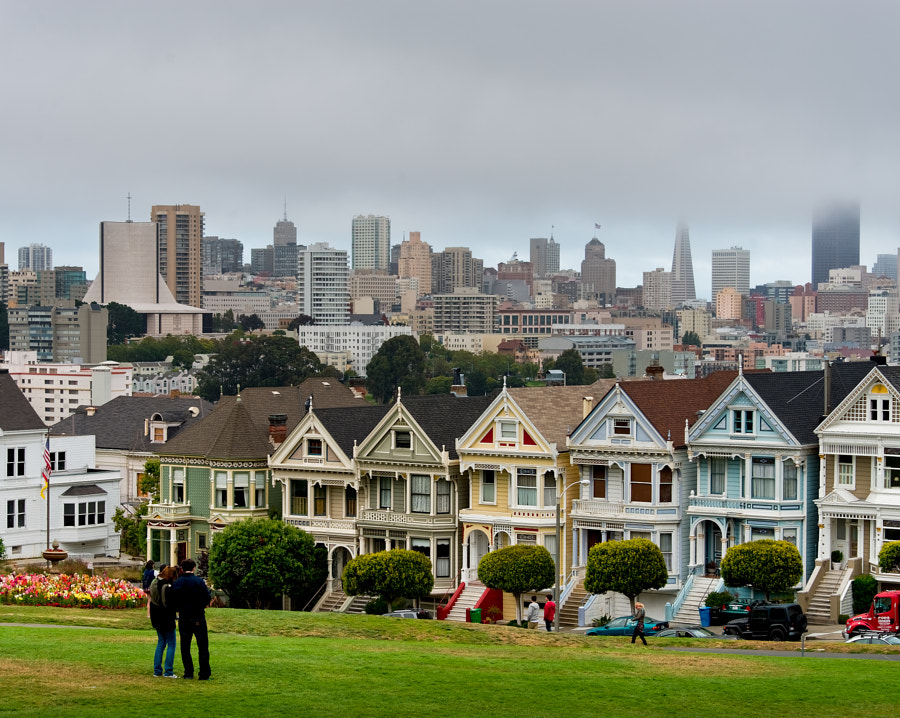 Victorian houses juxtaposed against modern buildings of downtown SF