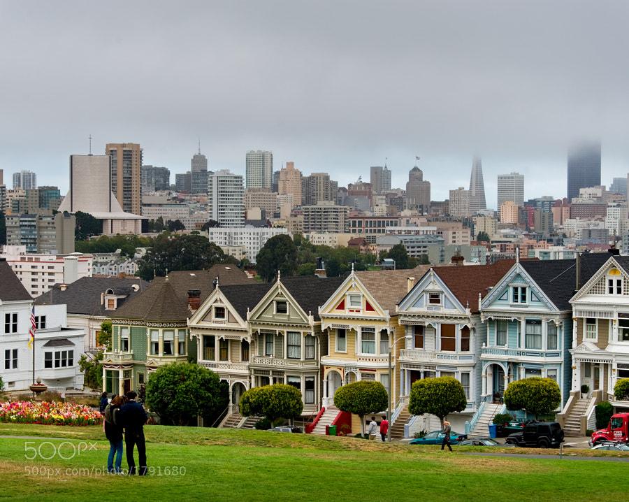 Victorian houses juxtaposed against modern buildings of downtown SF