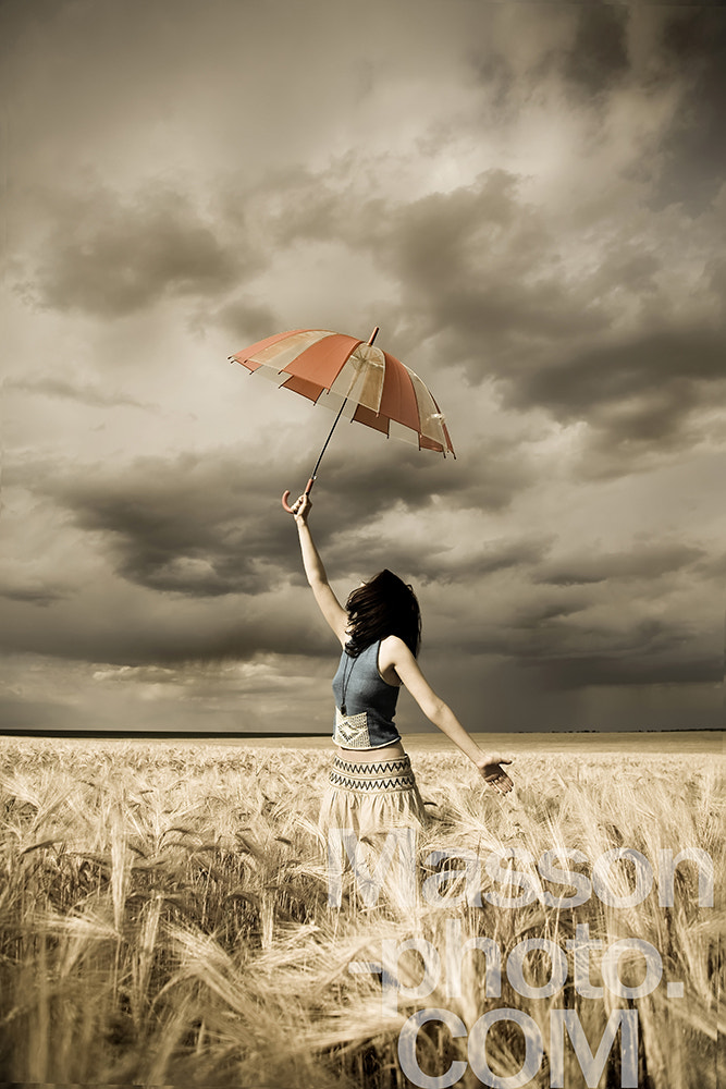 Photograph Girl with umbrella at field in retro style  by Vladimir Nikulin / Masson on 500px