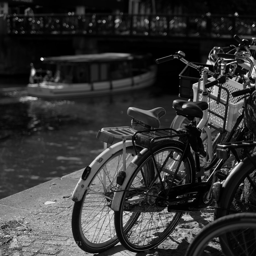 Bike at canal in Amsterdam 60
