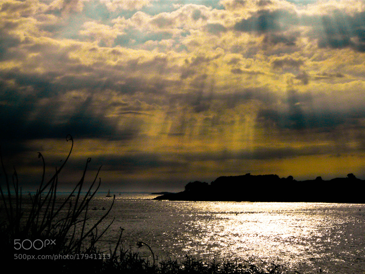 Photograph Divine Light guiding the boat to the coast by Marion Rousseau  on 500px