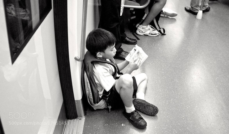 Photograph Manga reading Boy. by Pete Chang on 500px