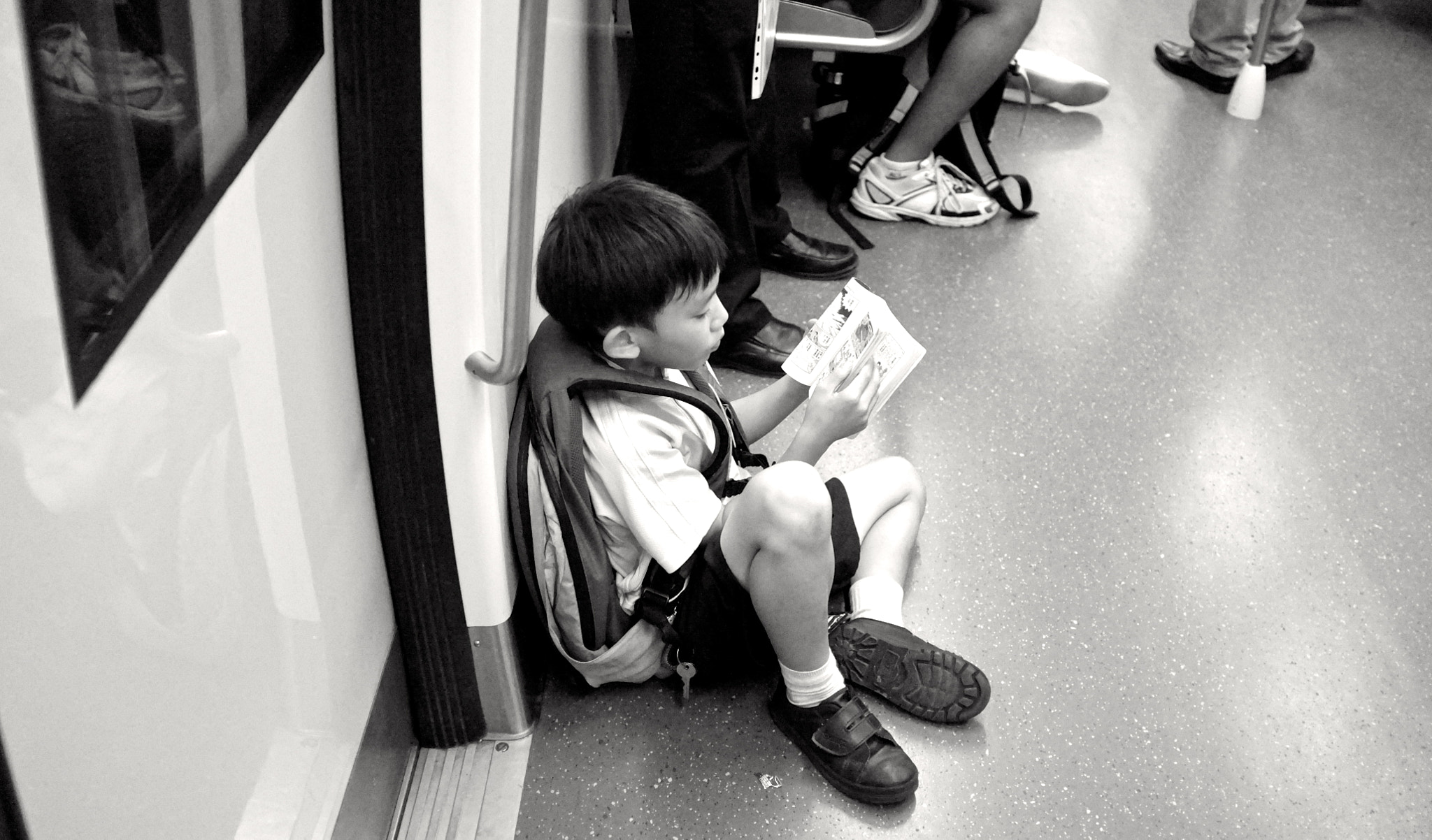 Photograph Manga reading Boy. by Pete Chang on 500px