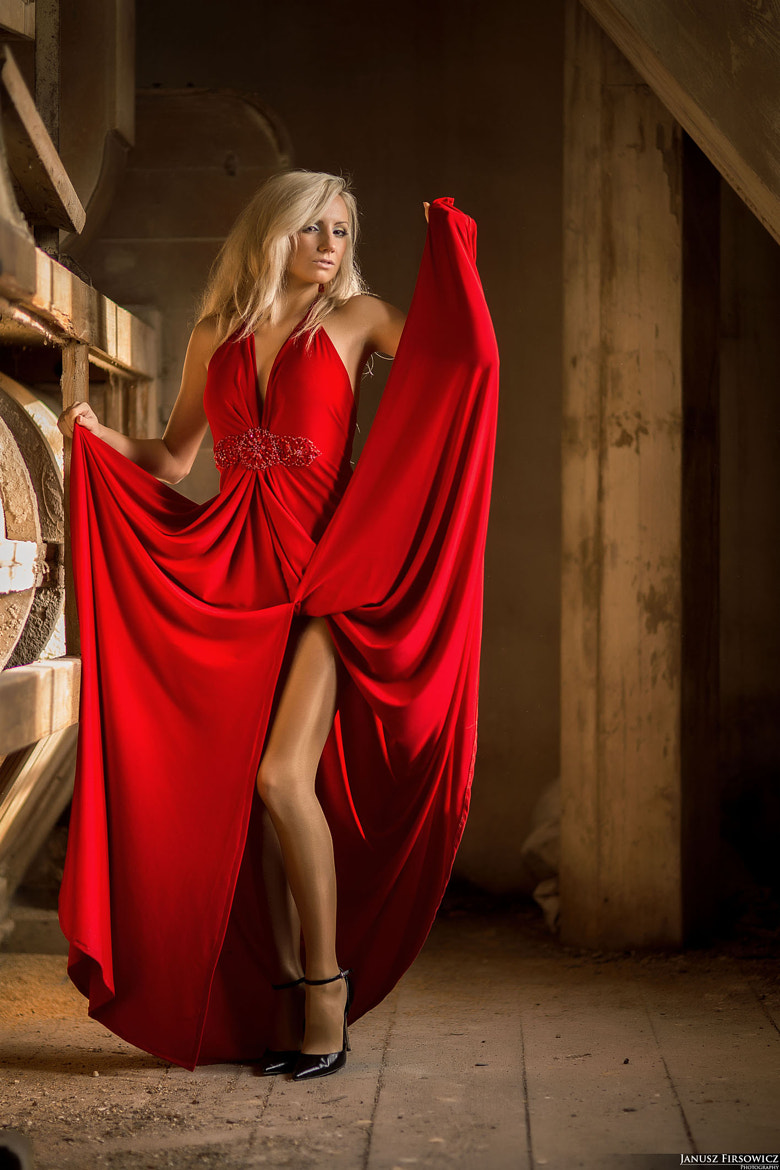 Photograph Woman in red by Janusz Firsowicz on 500px