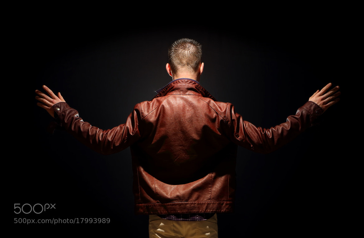 Photograph Young teenager on a black background, contrast rear view by Marek Mix on 500px