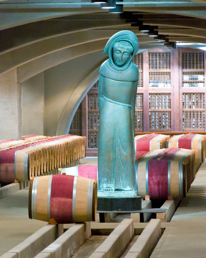 This sculpture by Beniamino Bufano from the 1950's depicts St. Francis. The Franciscan missionaries were the first to bring grapes to California. Shot at the Robert Mondavi Winery in Napa Valley, CA.