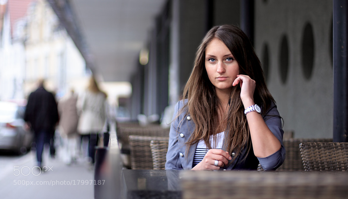 Photograph Young woman sitting in a bar by Marek Mix on 500px