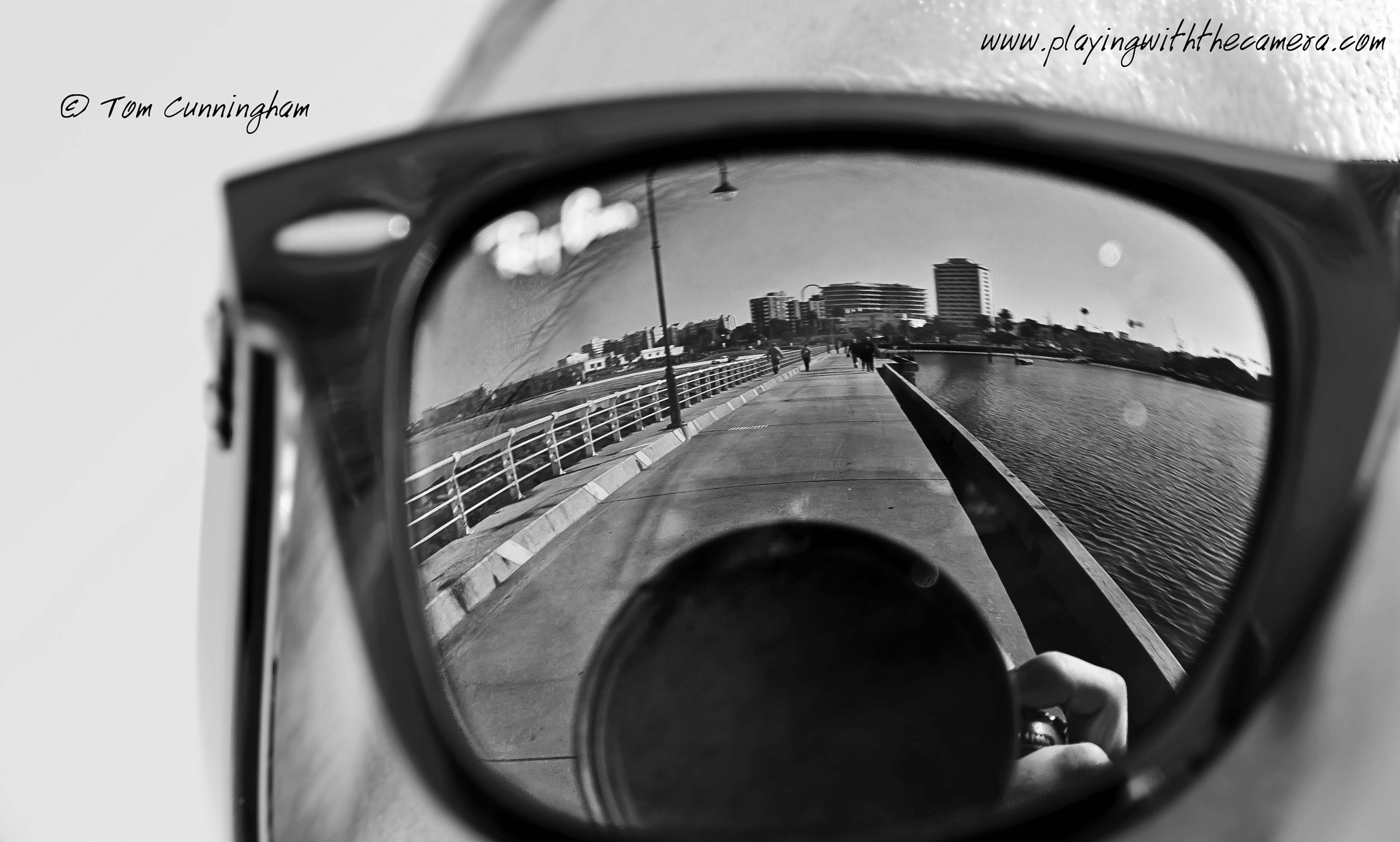 Photograph Reflection: City in Raybans by Tom Cunningham on 500px