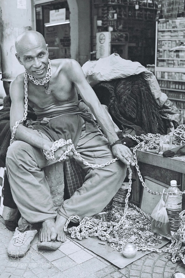 A happy homeless man at Chow Kit, Kuala Lumpur, Malaysia. (Taken with M6, Voigtlander 35mm f1.4 & Ilford B&W 400 Film)