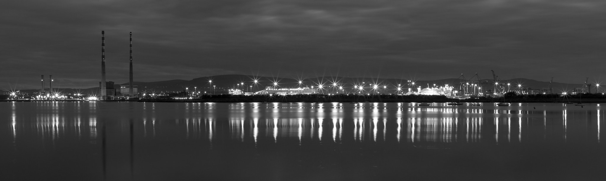 Photograph Poolbeg Panorama BW by Harry Guinness on 500px