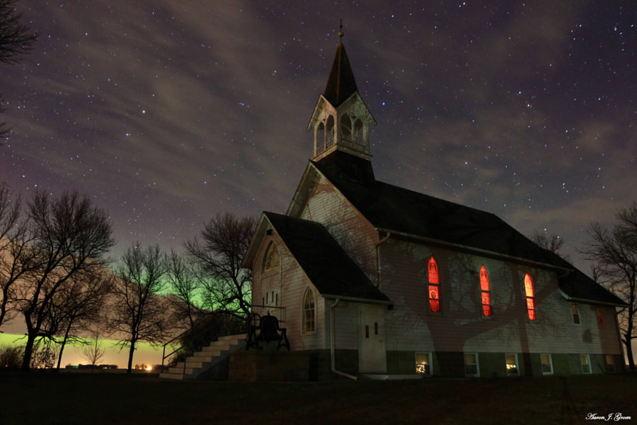 The historical Ben Clare United Methodist Church, Valley Springs, South Dakota. with this morning's kp 7 Aurora Borealis and some clouds.