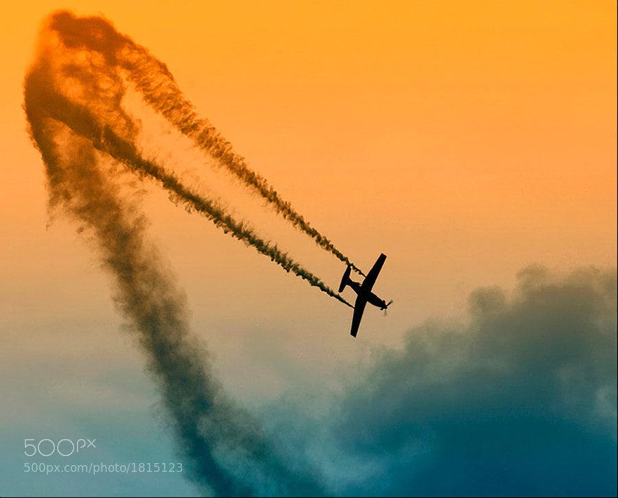Aerobatics at it's best. Shot taken five years ago during an airshow on a small field called Eelde near my hometown Groningen in the Netherlands.  Best regards, Harry