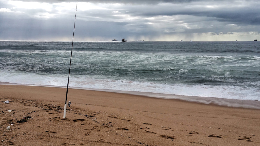 Waiting for a bite. Fishing on the beach at Umhlanga Rocks.