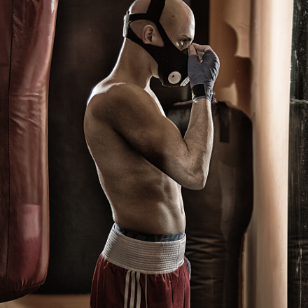 Boxer putting on a mask
