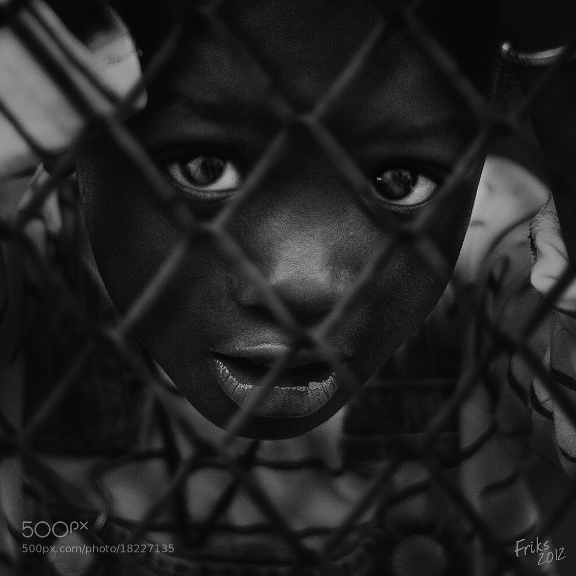 Photograph A CHILD AND A GRID by Mr Friks on 500px