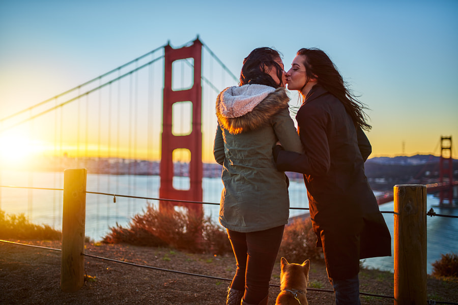 romantic lesbian couple kissing at golden gate bridge with pet dog by Joshua Resnick on 500px.com