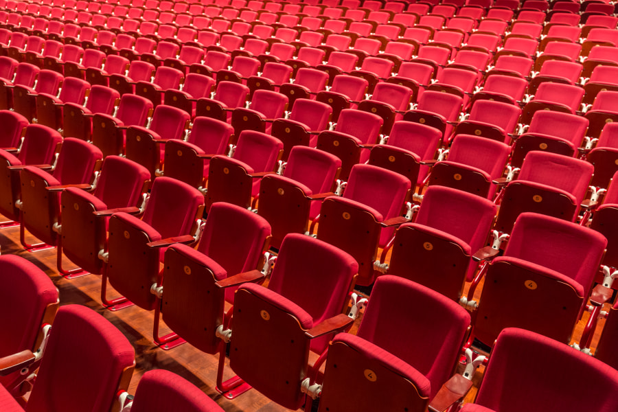 Red color theatre chair in conference room., автор — Matej Kastelic на 500px.com