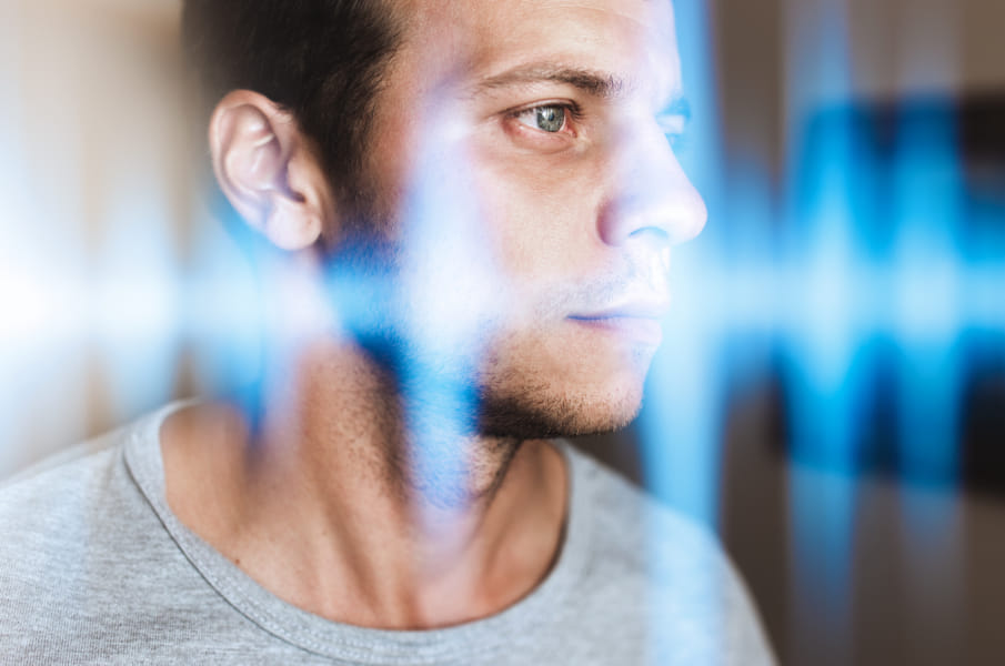 Multiexposure photo of a man and music waves