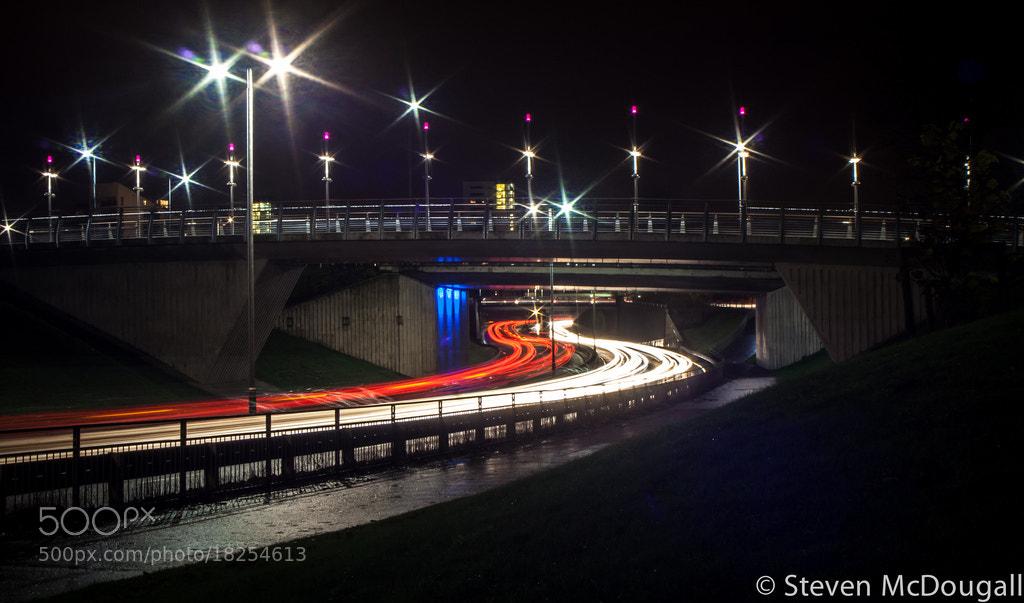 Photograph Light Trails Under Bridge To Riverside Museum Glasgow by Steven McDougall on 500px