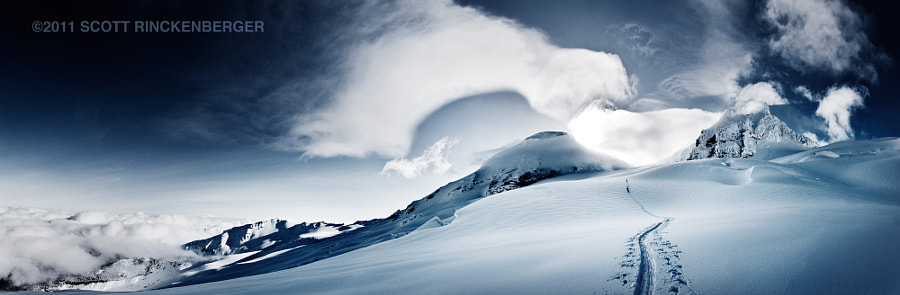 Sunrise on Mount Baker illuminates a cloud formation mirroring the shape of the mountain.  Taken during a mid winter ski descent of Mt. Baker.  This panorama is a composite of 20 vertical images stitched in Photoshop.  To see all of the amazing detail check out the hi res version here: http://bit.ly/r8x7kn