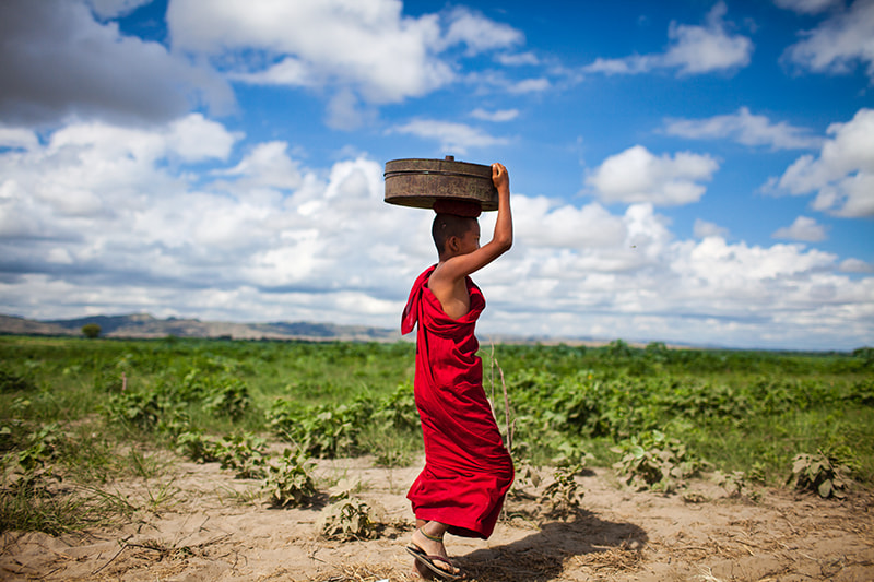 Photograph Walking monk by Etienne Bossot on 500px