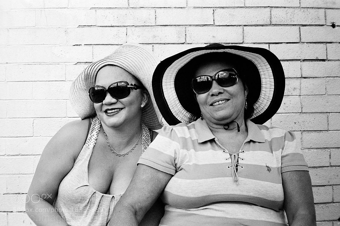 """Photograph """"Two Women In Hats (Dominican Day Parade 2012)"""" by B.C.  Lorio on 500px"""