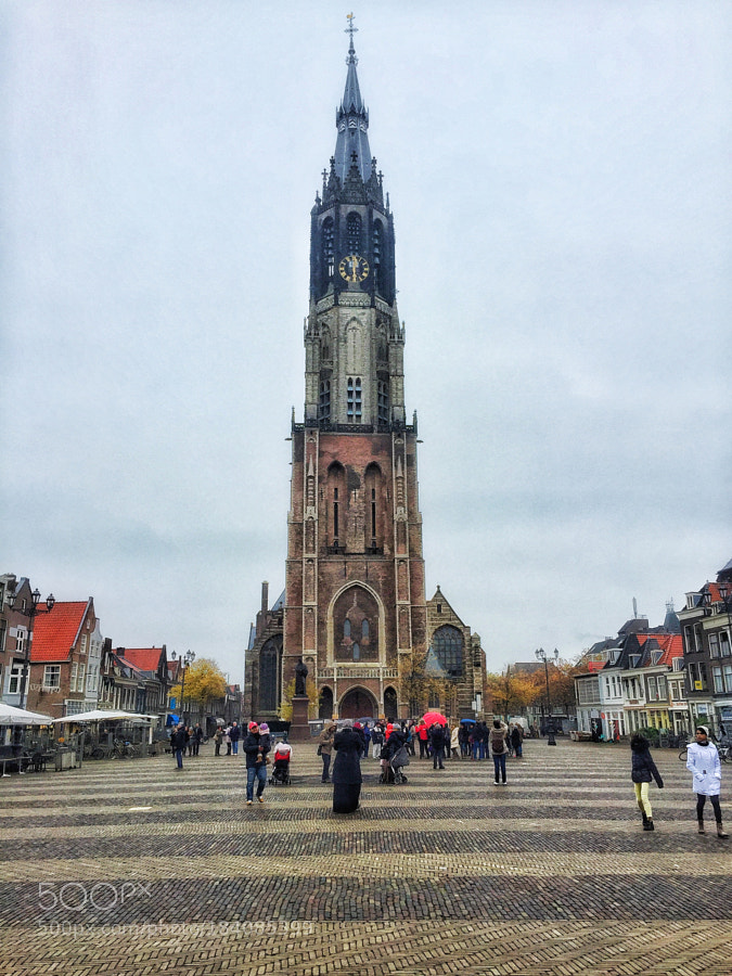 A colorful church on a grey day