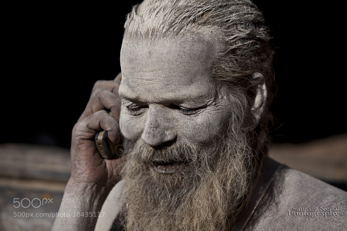 Photograph Ash smeared Sadhu with his cell phone  by Sanjeev Nepali  on 500px