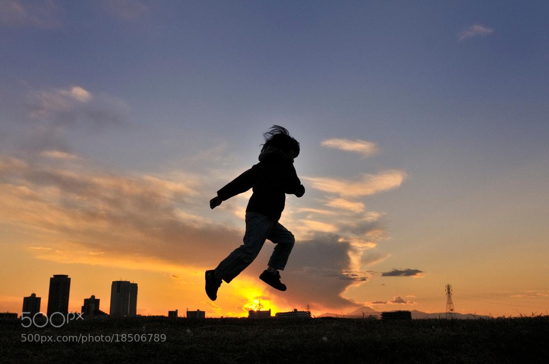 Photograph jump over the sun by nao sakaki on 500px
