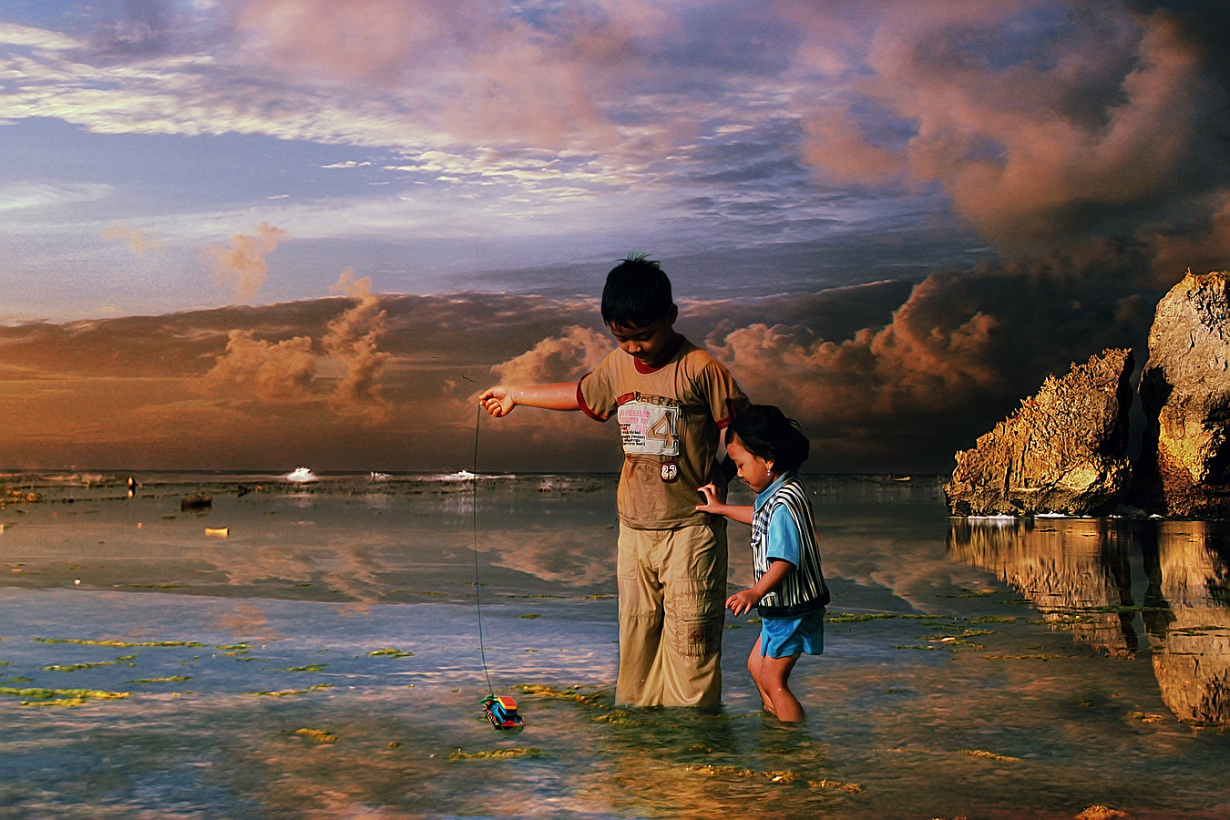 Photograph playing toy boat by 3 Joko on 500px