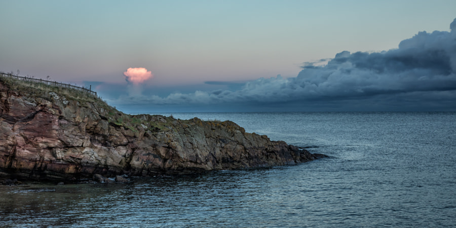 Rising sun lit cloud
