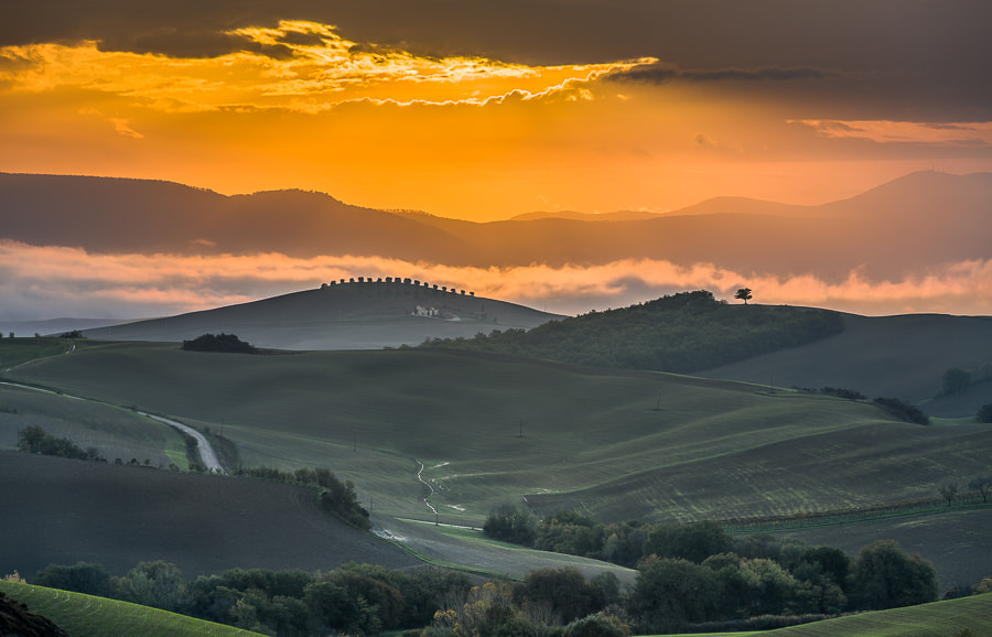 """<a href=""""http://www.hanskrusephotography.com/Workshops/Tuscany-Workshop-November-11/24503340_KkvZqW#!i=2224328612&k=X6K66fL&lb=1&s=A"""">See a larger version here</a>  This photo was taken during a photo workshop that I led in  Tuscany November 2012.  The photo is an HDR merged from 7 exposures 1 stop apart to capture all light without burning out any part of the bright light from the sun. The merge was done in the 32 bit plugin for Lightroom from Photomatix and then tone mapped in Lightroom 4.2."""
