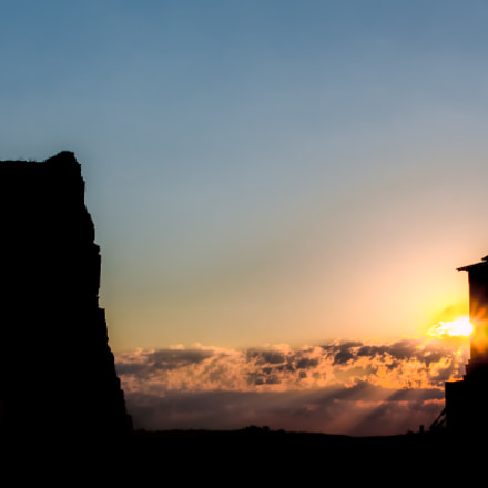 Sunrise over old castle ruins