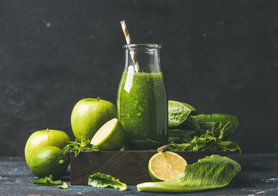 Green smoothie in glass bottle with apple, romaine lettuce, lime by Anna Ivanova on 500px.com